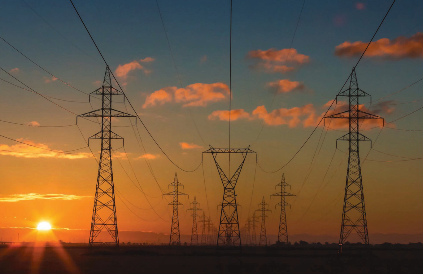 Image of Powerlines with setting sun behind Image