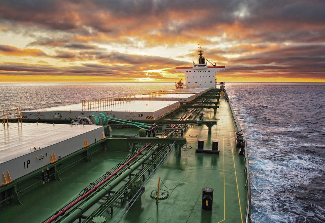Solar Today Magazine Photo - Image of a Cargo Ship crossing the Ocean at Sunrise - © Lukasz Z
